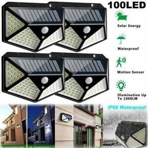 100LED-Solar-Power-Wall-Light-PIR-Sensor-Outdoor-gargen-Securite-Lampe-Projecteur