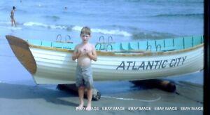 ATLANTIC CITY BEACH  VINTAGE SLIDE BOY POSING BY RESCUE BOAT GREAT PHOTO