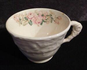 Vintage-Porcelain-Teacup-Unmarked-White-Raised-Design-With-Pink-Roses-Inside