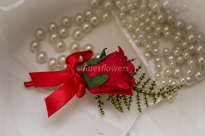 WEDDING FLOWERS SINGLE BUTTONHOLES IN RED