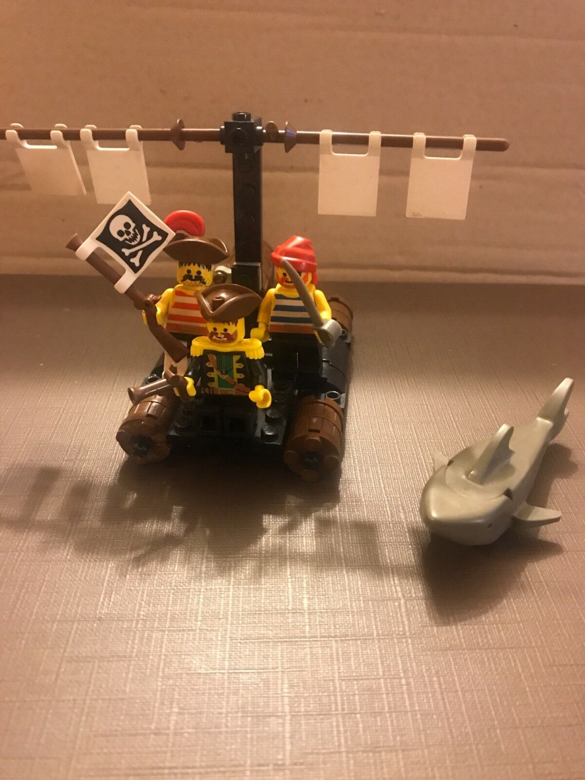 Lego pirate raft with 3 pirates and shark