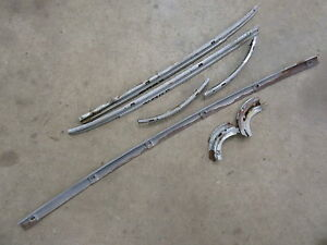 Details about 1957 Oldsmobile 98 88 interior rear window upholstery  mounting strips trim parts