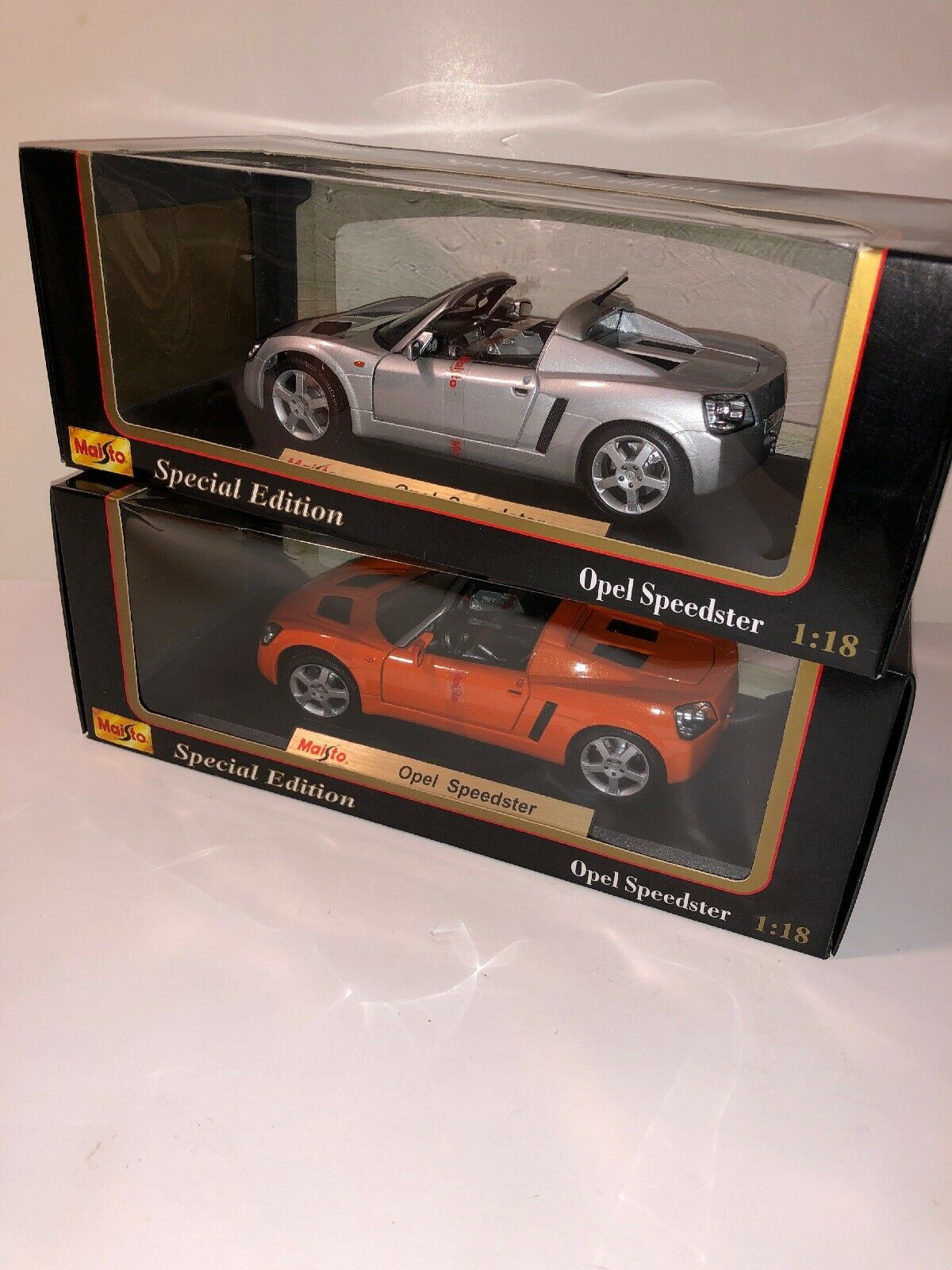 Maisto Opel speedsters 2 Pair Of 1 18th Scale Diecast Model Cars orange & Silver