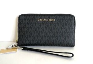 5579e2b9e876 NWT MICHAEL KORS JET SET TRAVEL SIGNATURE LARGE FLAT PHONE CASE ...