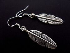 A PAIR OF DANGLY FEATHER EARRINGS WITH 925 SOLID SILVER HOOKS. NEW..