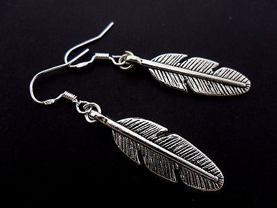 A PAIR OF DANGLY FEATHER EARRINGS WITH 925 SOLID SILVER HOOKS NEW..