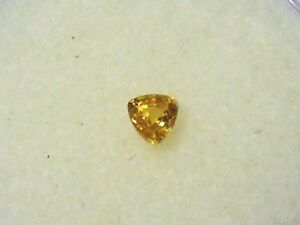 Natural-earth-mined-orange-yellow-trillion-sapphire-gem-0-26-carat