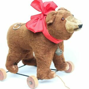 ANCIENT-BROWN-HUMP-TEDDY-BEAR-ON-WHEELS-c1920-1930s-WITH-VOICE-amp-BELL