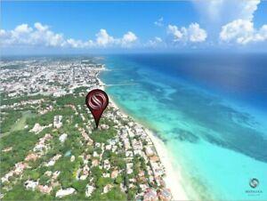 Propiedad con 2 departamentos a pasos de la playa en Playacar fase 1