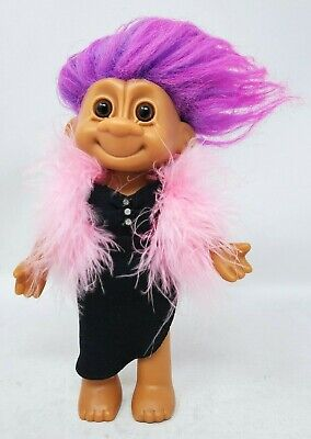 RUSS TROLL DOLL WITH PURPLE HAIR WEARING BLACK DRESS AND PINK BOA