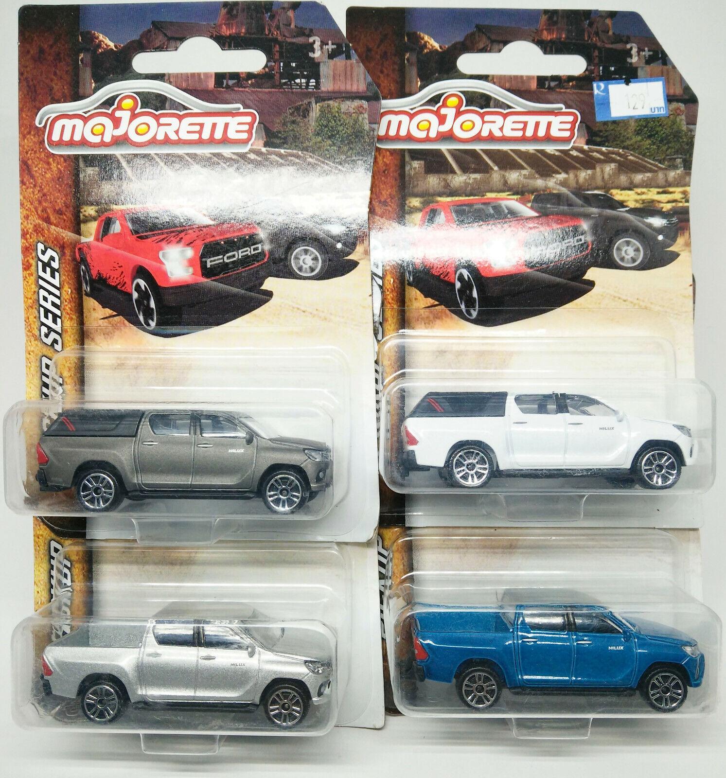 Majorette Toyota Hilux Revo Set of 4 colors White, Grey, Silver, bluee Scale 1 58