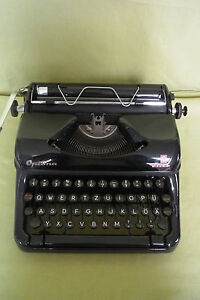 Machine à écrire-Optima Elite-VEB mécanique Optima machines de bureau Erfurt-e - Optima Elite - VEB Mechanik Optima Büromaschinen Erfurtafficher le titre d`origine 29odcPga-08051627-896730367