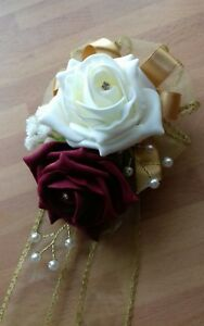 Wedding-flowers-maids-wrist-corsage-ivory-burgundy-gold-roses-diamante-pearls
