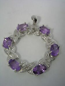 ROUND-PENDANT-HUGS-AND-KISSES-WITH-AMETHYST-AND-DIAMONDS-SET-IN-STERLING-SILVER