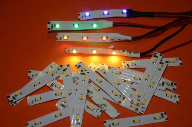 LOT de 4 ÉCLAIRAGES à LEDS 4 COULEURS  pour maquettes TRAINS ELECTRIQUES 12V CC