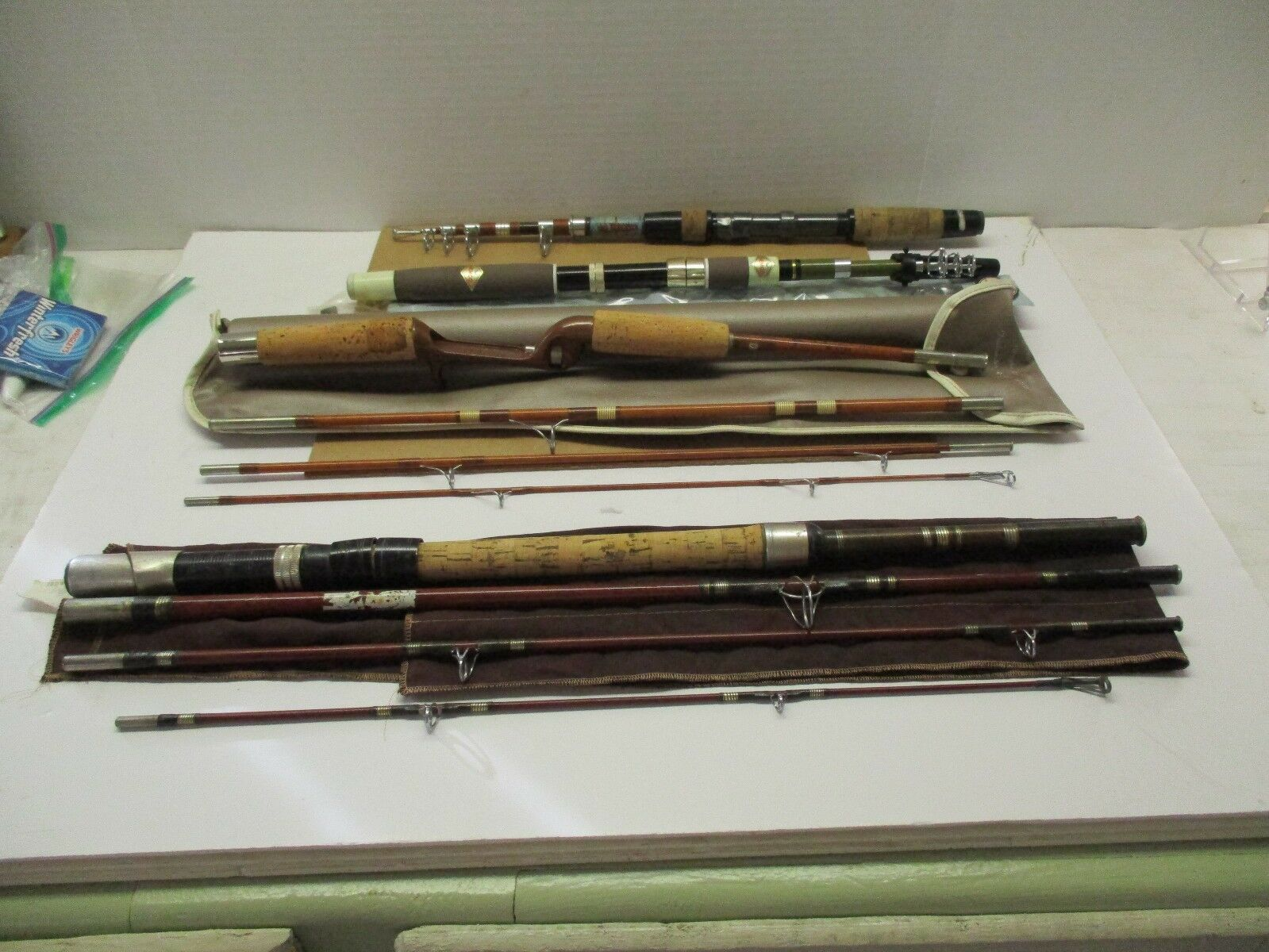 VINTAGE FISHING  RODS SET OF 4 MUST SEE   to provide you with a pleasant online shopping