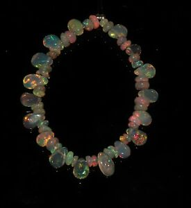 7-50-TCW-4-034-NATURAL-ETHIOPIAN-FIRE-OPAL-ALMOND-WITH-ROUNDEL-BEADS-DEMI-STRAND