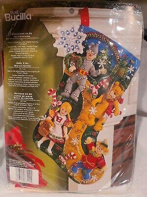 Bucilla Christmas in Oz  Wizard Scarecrow Lion Tin Man Holiday Felt Stocking Kit 86200