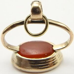 Antique-9ct-yellow-gold-watch-fob-pendant-seal-set-with-a-carved-intaglio-stone