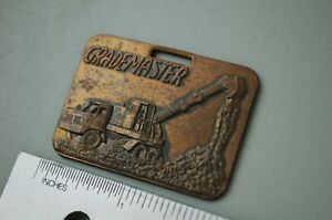 GRADEMASTER-EXCAVATOR-Vintage-Watch-Fob-brass-gradeall-truck-mounted-key-gift