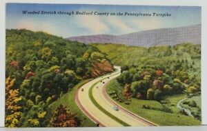 PA-Wooded-Stretch-through-Bedford-County-on-the-Turnpike-Vintage-Postcard-N13