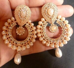 indian with water rings color product gold jhumka earrings
