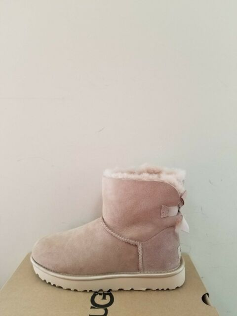 5eb3a9d810f Ugg Australia Women's Mini Bailey Bow II Metallic Boots Size 11 NIB