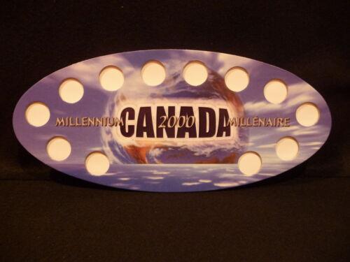 #7 2000  MILLENNIUM  25 CENT SOUVENIR OVAL GLOBAL  HOLDER CANADA