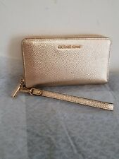 8bf0a60dde7d1 100% Authentic Michael Kors Mercer Large Leather Smartphone Wristlet Pale  Gold .