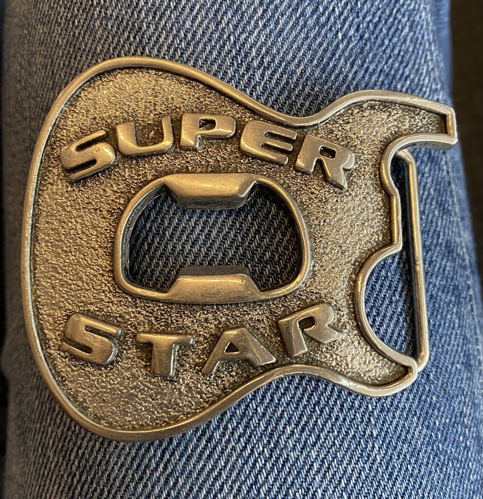 Super Star music belt buckle bottle opener in the centre.