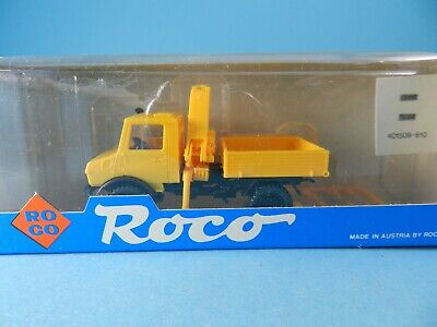 ROCO  MERCEDES BENZ UNIMOG U1300L MIT PLANE ORANGE 1:87