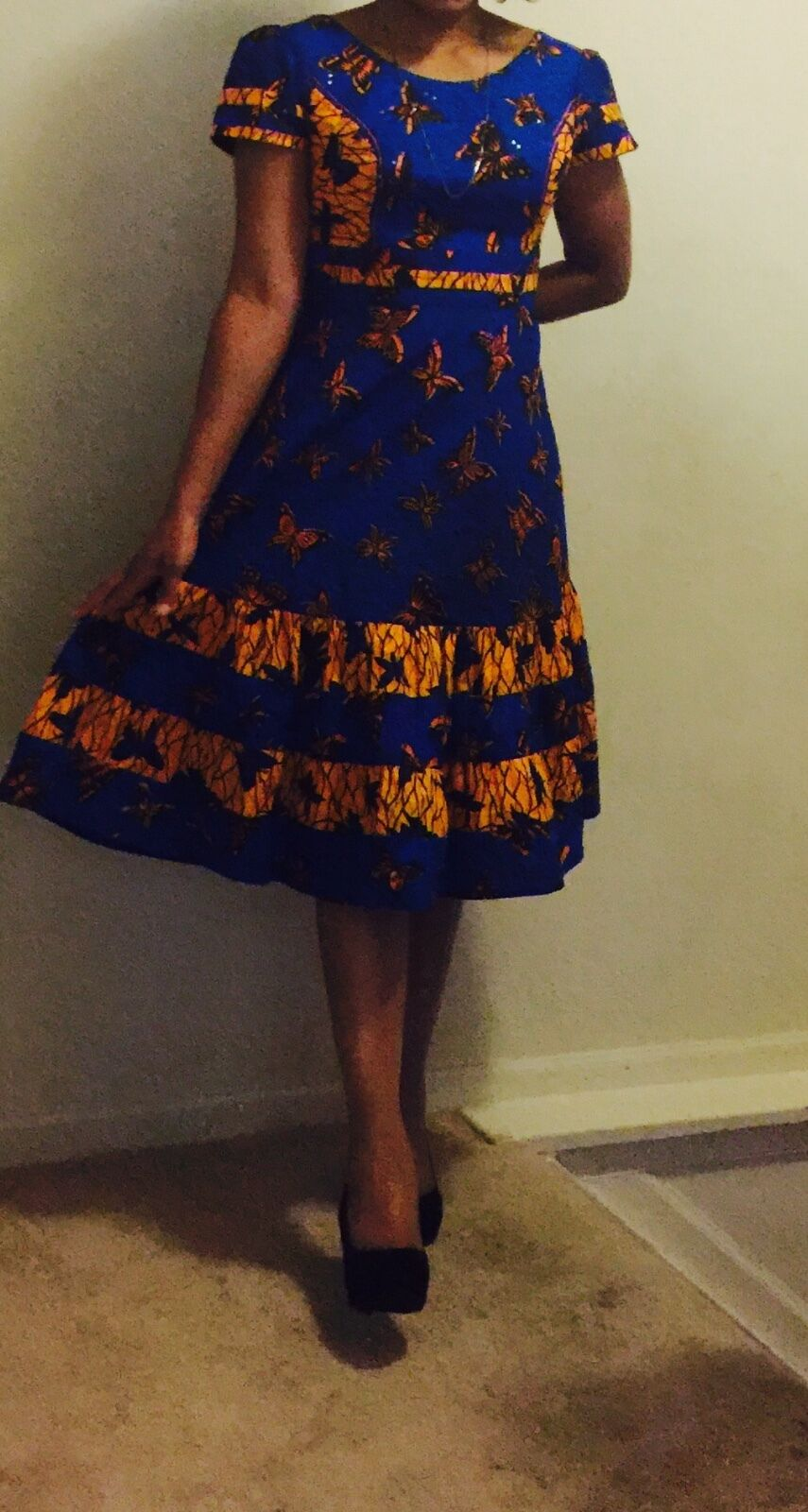 Simple but dressy short sleeved blueee and yellow ankara dress in size 14.
