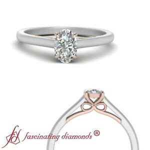 Bow-Pattern-Solitaire-Engagement-Ring-With-1-2-Carat-Oval-Shaped-Diamond-Center