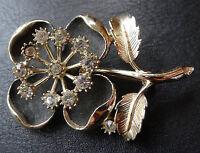 vintage 3D clear rhinestone black flower brooch gold tone c. 1960s -D524
