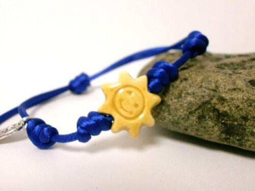 """Pulsera  /"""" Sole Mio /"""" charm de cerámica en color amarillo e hilo azul de 3mm"""