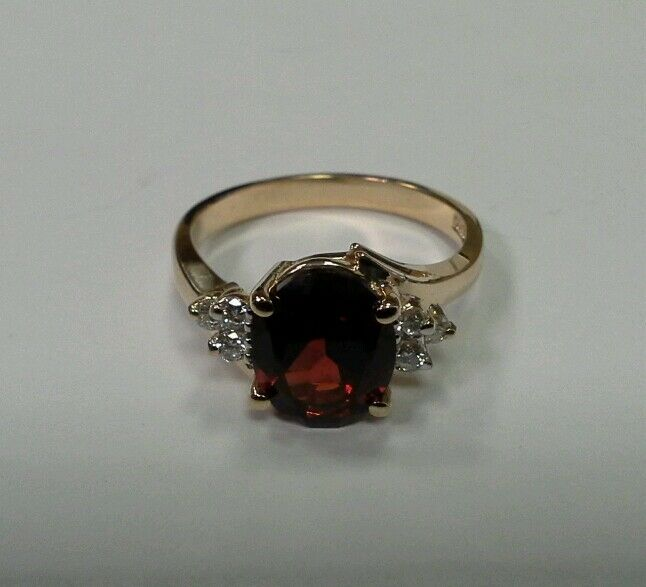 14k Yellow gold Ring 2.8 carat Garnet Center and .18 carat Diamonds Size 7
