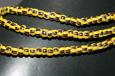 6 mm Strang gelb rot schwarz gestreifte Glasperlen aus Ghana Trade Beads