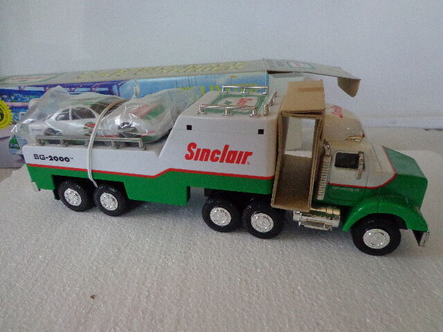 SINCLAIR CLASSIC RACE CAR CARRIER FROM 1997 W WORKING LIGHTS, SOUND & RACE CAR