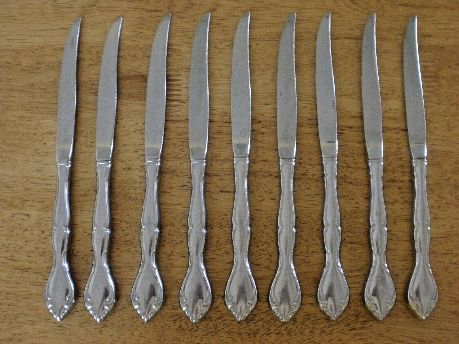 ONEIDA DELUXE USA Stainless STRATHMORE c1991 Set of 9 STEAK KNIVES 9-1 8  VG 849
