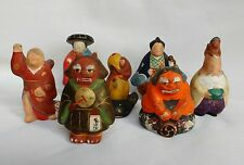 Superb collection of seven Japanese low fire ceramic dolls figures statuettes