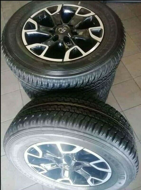 """18"""" Toyota Legend 50 mags with brand new 265/60/18 Dunlop Grandtrek AT set for R14799."""