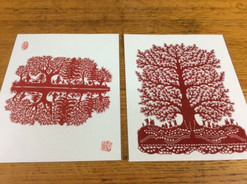 Pair of Chinese paper cut out folk art silhouettes trees children playing in red