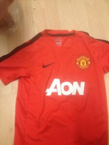 super popular e3c84 5793a Details about Manchester United training top 137-147cms 10 to 12 years NEW  AON ONE ONLY !!!