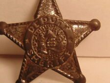 Old toy tin star badge made in Japan, center has 2 topless women in grass skirts
