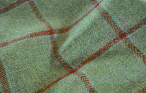 Tweed material by the metre or yard in green with red windowpane pattern