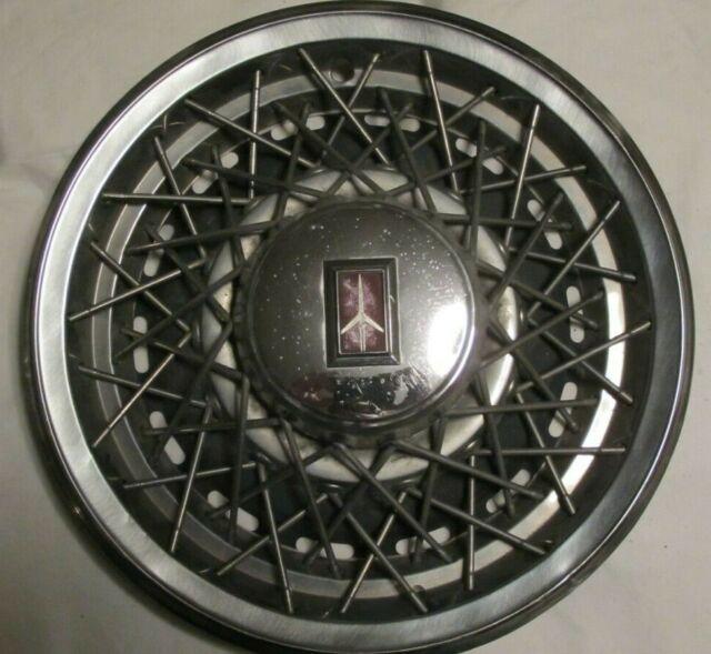 """(1) OEM 1980-84 Oldsmobile Delta 88 15"""" Wire Spoke Hubcap Wheel Cover"""