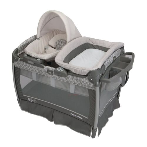 Pack 'N Play w Cuddle Cove LX Rocking Seat by Graco