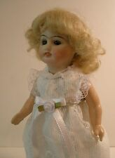 """Antique 9"""" German open-closed mouth bisque socket head doll, very rare"""