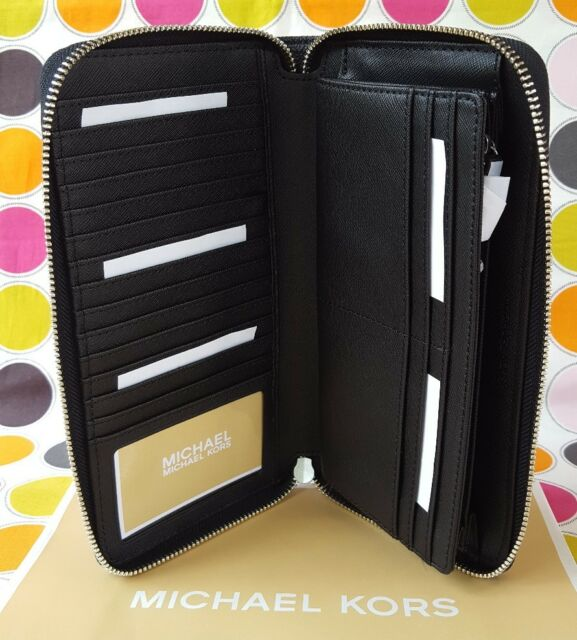 8878b4b42e81ea NEW MICHAEL KORS SIGNATURE PVC JET SET TRAVEL LARGE ZIP WALLET IN BLACK.