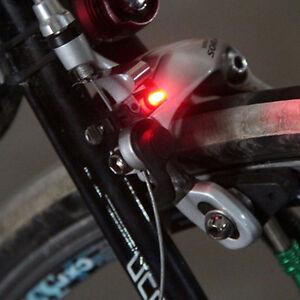Luce-frenata-freno-bici-bicicletta-LED-rosso-sicurezza-luminoso-freni-tipo-V-e-C